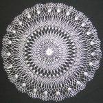 Chandelier doily made using circular netting.