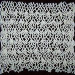 Net dishcloth made using the Lantern Stitch